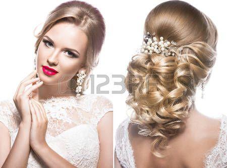acconciature: Bella donna bionda in immagine della sposa con i fiori. Bellezza viso e Acconciatura. Foto scattata in studio
