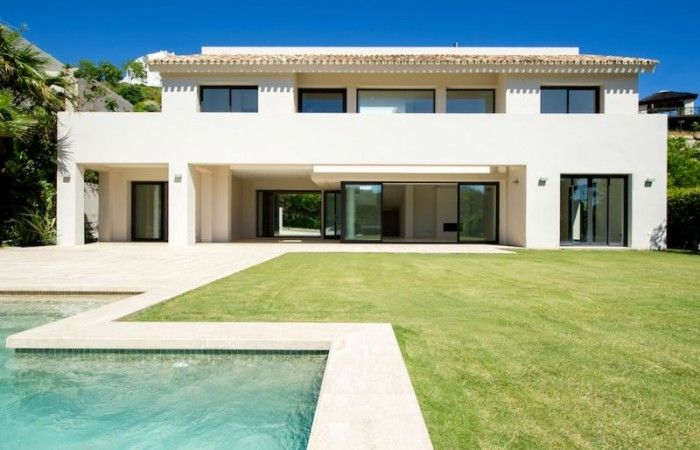 Amazing contemporary Villa within the five star Los Arqueros Golf resort. Spectacular design with space light and stunning views all for 2 million euros. This is the dream home in marbella!