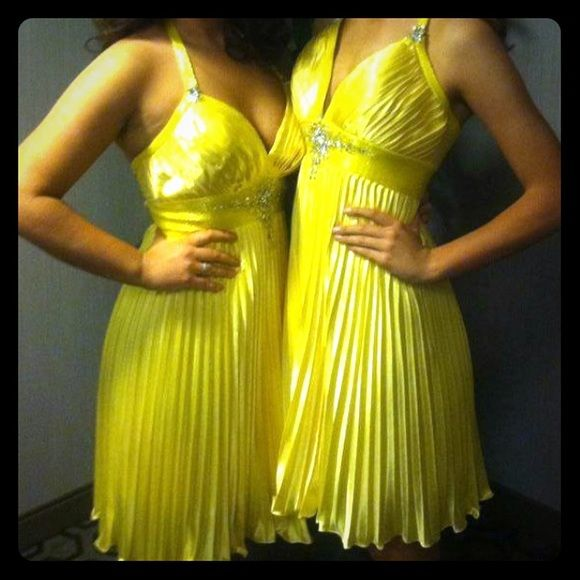 Yellow Cocktail dress Cute halter top cocktail dress worn for about 10 minutes. Sewed up the bust part just a little bit but can easily be taken out.  Price is negotiable!! Dresses Mini