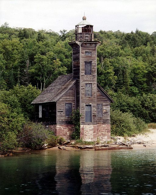 The abandoned Grand Island East Channel Light, Grand Island, MI. Guarding the shores of Lake Superior on Michigan's Upper Peninsula, this square wooden lighthouse was in use from 1870 to 1913. While the lighthouse is not accessible to the public, it can be seen by boat.
