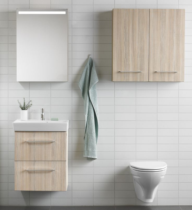 Gain extra storage space by utilising the area above the toilet for a wall cabinet or two.