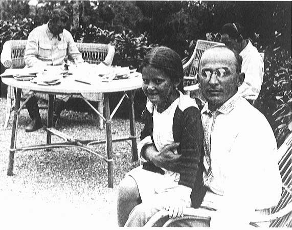 Lavrentiy Beria with Stalin (in background) and the young Svetlana Alliluyeva.
