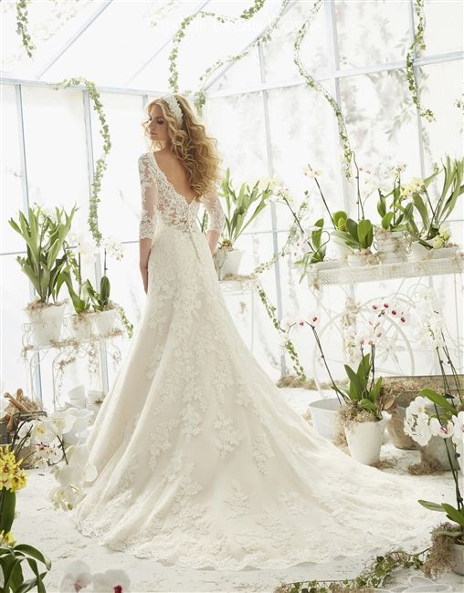 2016 Romantic Lace Back #Wedding Dress ♥ Lace on Tulle Fit & Flare A-Line Gown with a Illusion Lace Scalloped V-Neck Over Sweetheart Interior, Illusion Lace Elbow Sleeves, Lace Fitted Bodice Past Hips, Lightly Padded Bust and Boning, Cascading Lace A-Line Skirt with Scalloped Lace Hem, Chapel Train, Illusion Lace Mid V-Back with Low Back Interior and Covered Buttons. #laceweddingdress #customweddingdress #weddingdresswithsleeves #laceback #alinebridalgowns #bridalgowns #weddingdresses