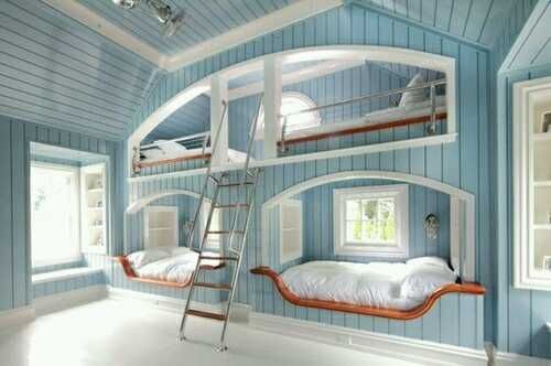 A Beach house with built in bunk beds would be so sweet and the baby blue colour on the walls makes it an over the top show room.