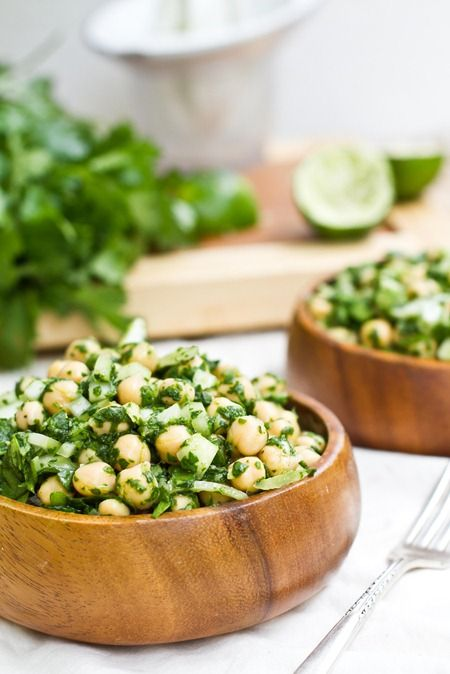 CILANTRO LIME CHICKPEA SALAD Yield: 1-2 servings.    Ingredients:        One 15-oz can chickpeas (2 cups cooked), drained and rinsed      2 cups spinach      1/4 cup sweet onion, chopped finely      Juice from 1.5 limes      3/4 cup fresh Cilantro      1/2 tsp sugar (or to taste)      2 tsp Dijon mustard      1 garlic clove      1 tsp extra virgin olive oil      1/2 tsp ground cumin      1/2 tsp kosher salt + ground pepper