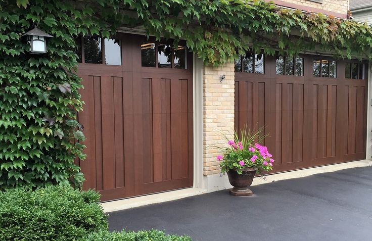 Gorgeous Clopay Canyon Ridge Limited Edition doors in Walnut. Love the ivy how it just hugs and loves the doors!!