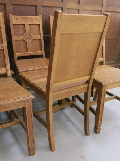 Classic Antique Oak Simple Gothic set of 7 Ministers Chairs From Muswell Hill URC.  Classic victorian design with cross emblazoned stretcher, gothic IHS centrepiece and blind cutaways.