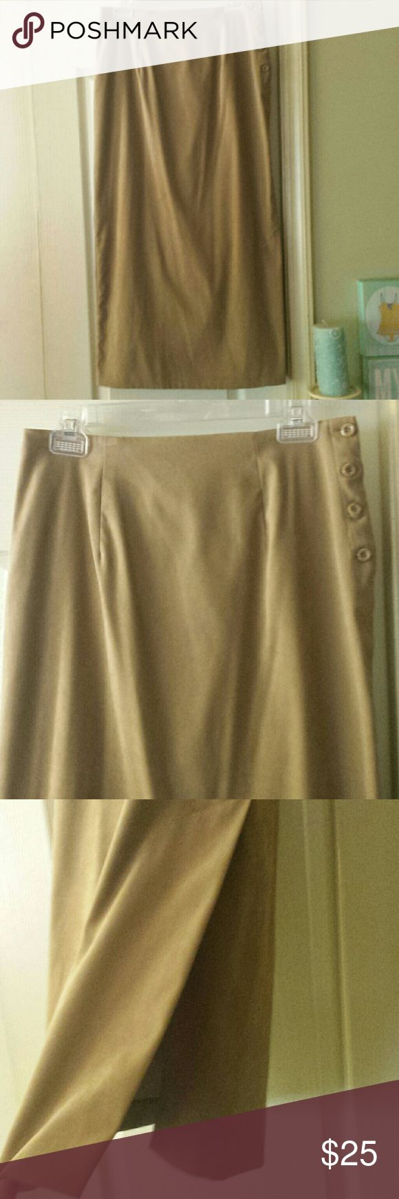 Studio C Tan / Camel Maxi Skirt. Size 12. Very pretty camel color / tan maxi skirt by Studio C. No stains or holes. Buttons on side and has long slit on side. The material is super soft! You can see it best in pic 6. Pic 7 shows material content. Size 12. Very good used condition. Looks awesome with boots! Only worn a couple of times. Size 12. Studio C Skirts Maxi