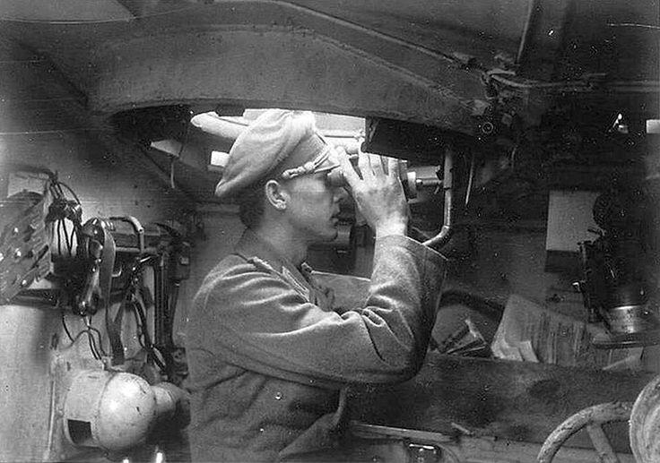 interior shot showing a StuG-Kommandant in action