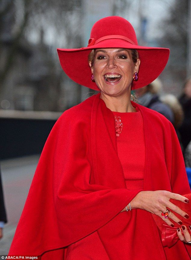 Maxima wore head-to-toe crimson, pairing her fitted midi dress with an equally bright ponc...
