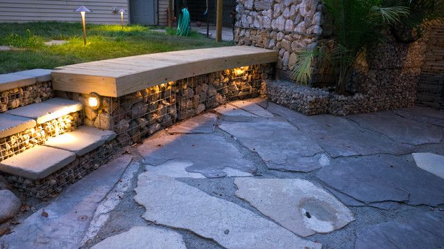 Gabion Walls - What They Are And How To Use Them In Your Landscape. Use in sunken patio. Love the lighting feature.