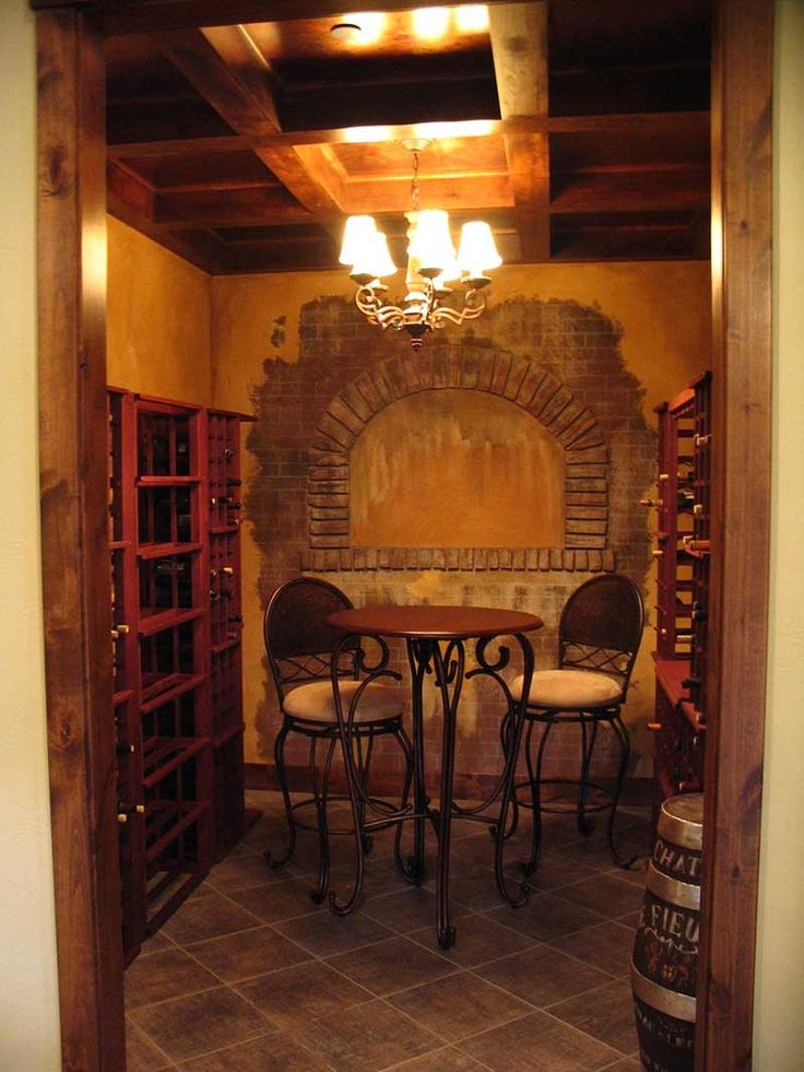 Colima Manor Mountain Home Wine Cellar Photo from houseplansandmore.com Love the beautiful table and chairs.