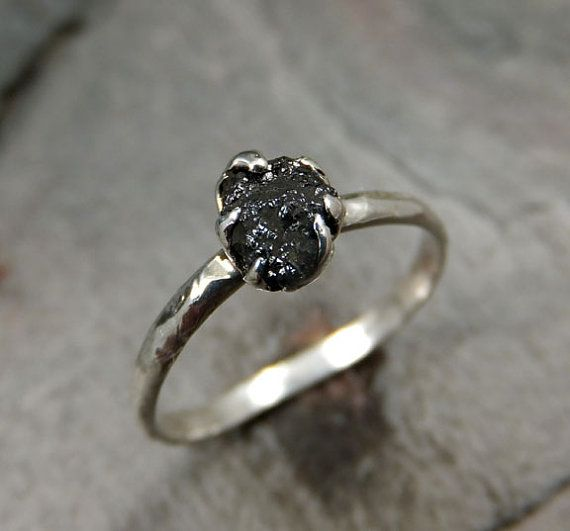 This is the diamond I can make an exception for. It's conflict free, and also nontraditional (black and rough/raw) so it doesn't perpetuate the marketing campaign of diamonds = love or falsely inflate the value of diamonds. I'm seriously loving this ring.