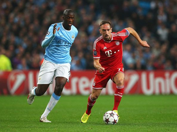 Franck Ribery of Muenchen takes on Yaya Toure of Manchester City during the UEFA Champions League Group D match between Manchester City and FC Bayern Muenchen at Etihad Stadium on October 2, 2013 in Manchester, England.