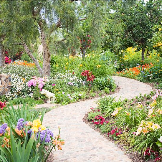 Back Yard - Path and walkway landscaping. So many beautiful perineals; a riot of balanced color.  I love a wide , curving walkway to enjoy my garden strolls. #bhg.com
