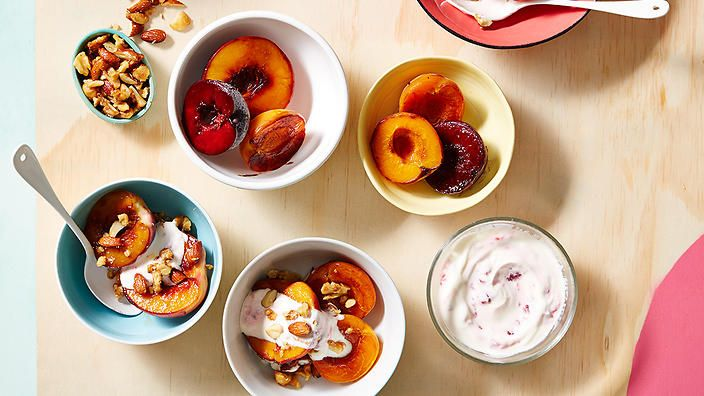 Caramelised stone fruit with crunchy nut crumble and raspberry yoghurt. It's a healthy dessert we'd happily eat for breakfast. Recipe from @HealthyZest. #wholefood