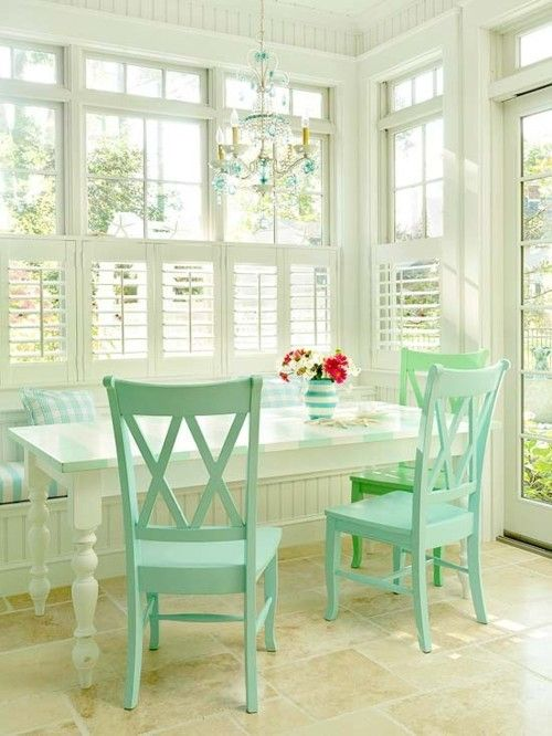 Adoring this bright and open breakfast nook space.  The wall to wall and ceiling to floor windows are amazing!  Love the white table & the aqua blue chairs.