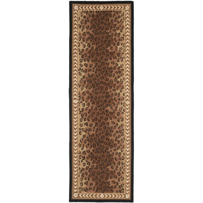 Give any room a functional yet stylish addition with this hand-hooked wool runner rug. The rug is crafted from virgin wool and features a brown background with a beautiful design done in stunning accents of black, brown, beige, and ivory.