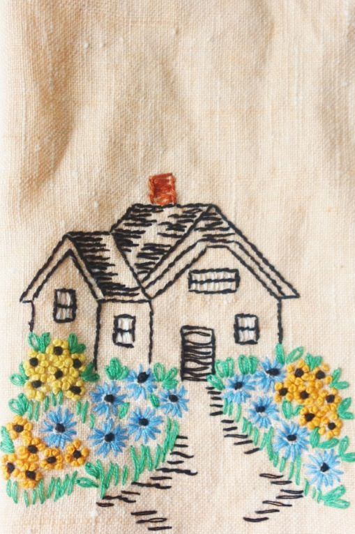 Embroidery of a cottage.