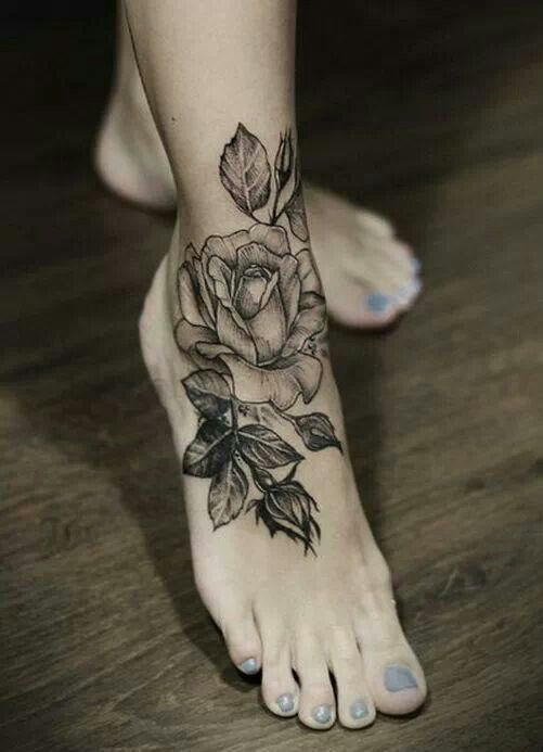 Black and grey rose on front of ankle/to of foot