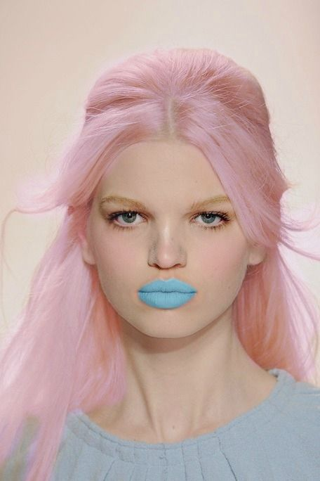 Can one speak with such color on the lips? Is such blue and pink meant to trap conversation?