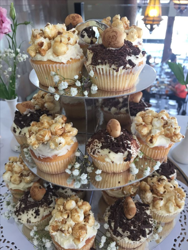 Popcorn vanilla cinnamon cupcakes and panda chocolate biscuit topping