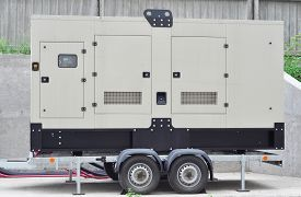 Image of generator - Big Backup Mobile Generator for Office Building Connected to the Control Panel with Cable Wire to the Office Building - JPG