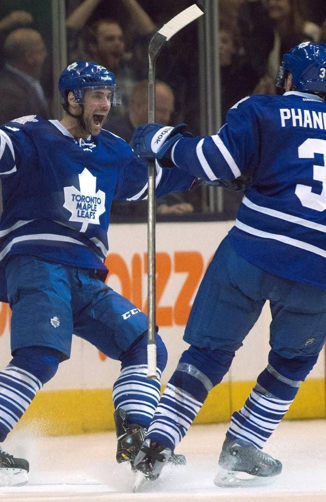 Trevor Smith celebrates his game winning overtime goal with Dion Phaneuf. Dec. 5, 2013. (AP Photo/The Canadian Press, Frank Gunn)