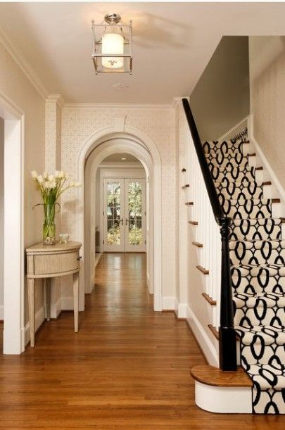 The Hall way is just gorgeous! Love the contrast of the wood with the white!