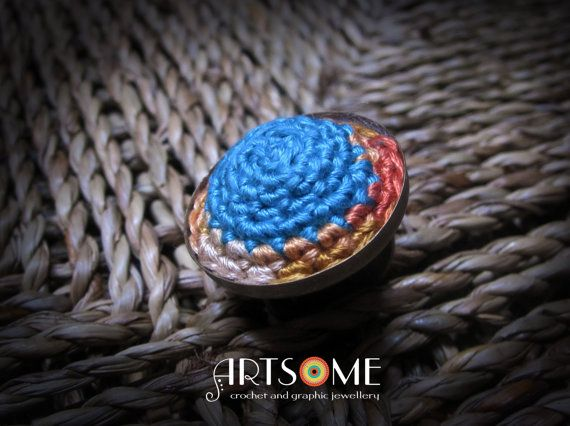 Crochet Mandala ring on adjustable brass base - turquoise and orange thread #Jewelry #Rings #StatementRings #domeshape #circle #crochetedring #decorativebigring #lightblue #darkblue #boho #handmade #unique #artistic #mandala #crochetedjewelry #adjustable #ring #oneofakind