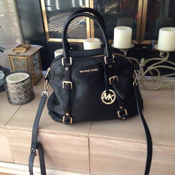Michael Kors leather handbag with shoulder strap Authentic like new Michael Kors handbag. with gold hardware. Spotless inside and out. Zipper compartment  and pockets. Zipper closure. Nice size 14 x 11.  PRICE IS FIRM Michael Kors Bags