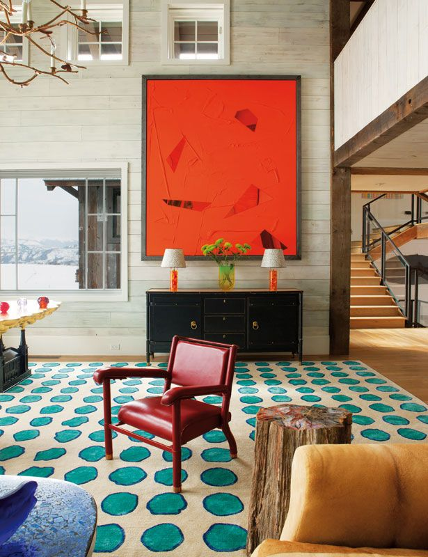 A great area rug: Frank de Biasi Interior, Aspen. great color combo, orange and turquoise, polka dots.