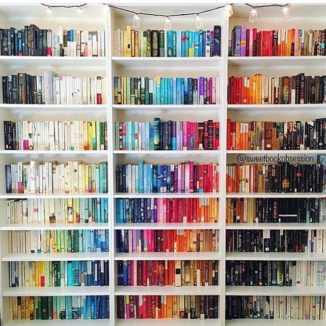 @sweetbookobsession has the most glorious rainbow-colored shelves arranged on a diagonal!