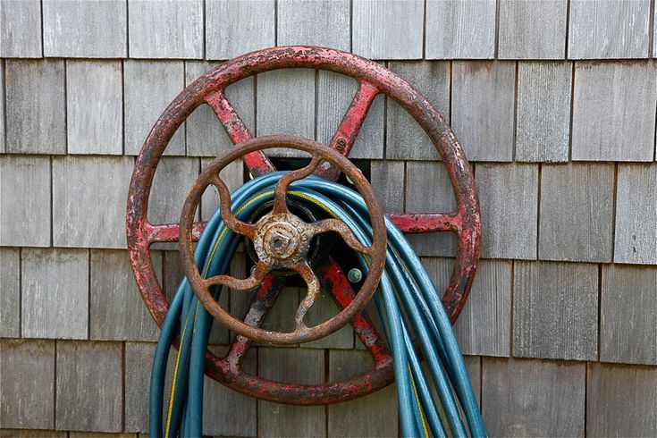 vintage steering wheels used as hose holders