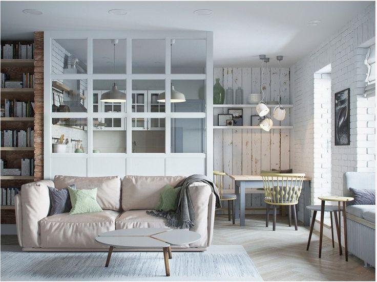 Между кухней и гостиной вместо глухой стены сделана стеклянная перегородка, которая пропускает свет в обе стороны.