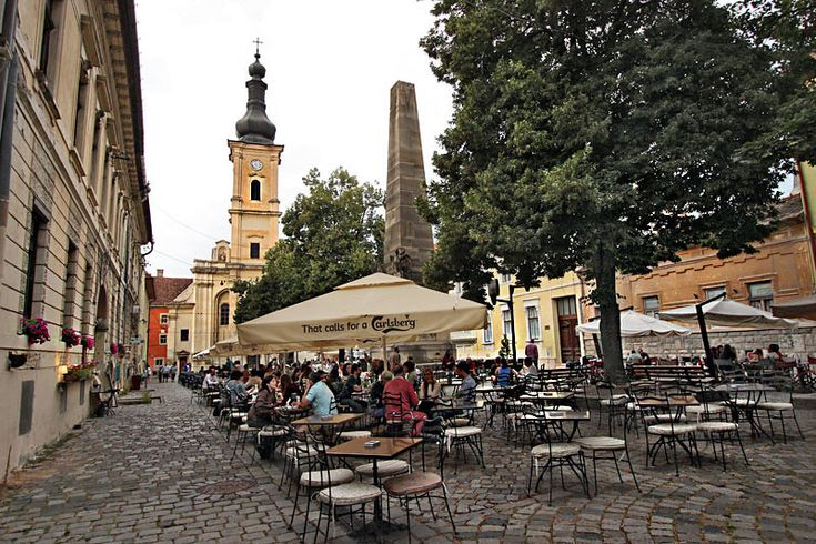 Outdoor cafes fill Museum Square in Cluj-Napoca, Romania, the city's most popular gathering spot