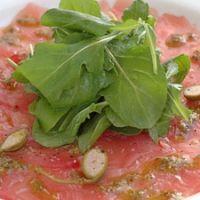 Tuna Carpacio With Basil Oil Lemon And Caper Berries Recipe