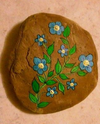 Hand painted blue flowers on a rock