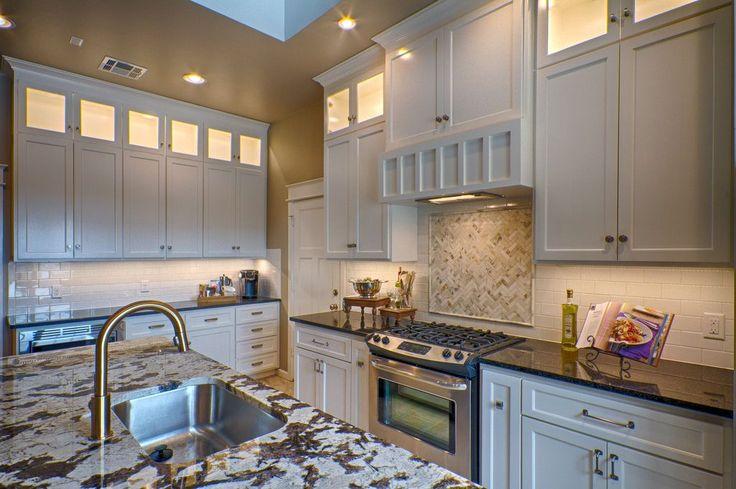Transitional Kitchen with Subway Tile, Hanover Flat Panel Cabinet Door, High ceiling, Stone Tile, flush light, Skylight