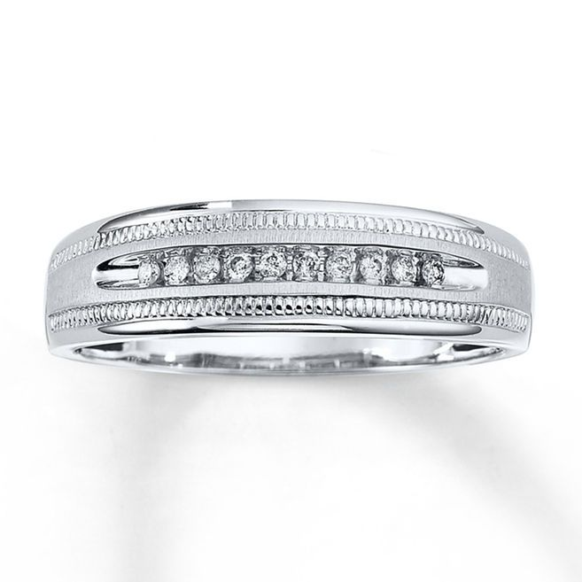 This Handsome Mens Band Features A Row Of Diamonds Totaling 1 10 Carat In Weight