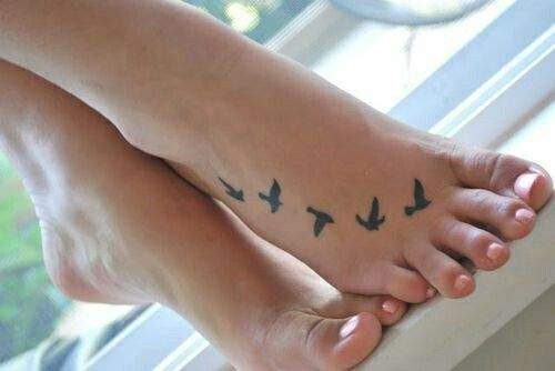 Black birds small from big toe stitched heart to full wing span to ankle tattoo
