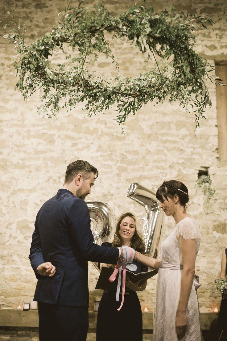 Foliage ring. greenery chandelier - An elegant English countryside barn wedding in Oxfordshire. Photography by Tom Ravenshear. The bride wears a dress by designer Sienna Von Hildemar