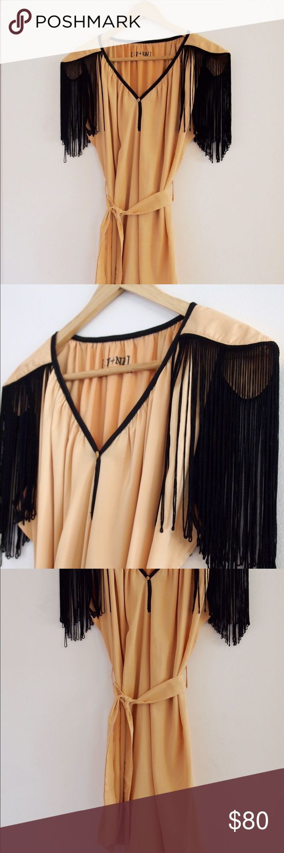 Fringe Cocktail dress Very Unique item! I bought this in Australia in Sydney & maybe wore it once. It's in excellent condition & soo comfortable! Could be worn as a cocktail dress or even as a Costume piece for a 1920's style party or a Halloween costume! Dresses Mini