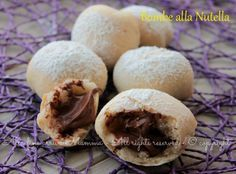 Bombe nutella,piccolissime palline di pasta lievitata croccante,che nascondo un interno tutto goloso.Ideali per colazione,merenda,dopo cena;una tira l'altra