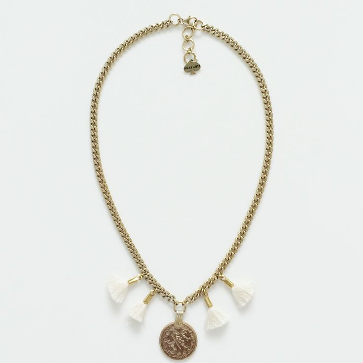 The Cream Fringe Oasis Necklace is made from gold plated chain, coins and hand made French cotton tassels. (45cm incl. clasp & extension chain)