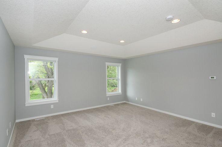 Master Bedroom   Walls: Sherwin Williams SW 005 Light French Grey   Trim: Sherwin Williams SW 7005 Pure White   Carpet: Shaw 111 Mangrove
