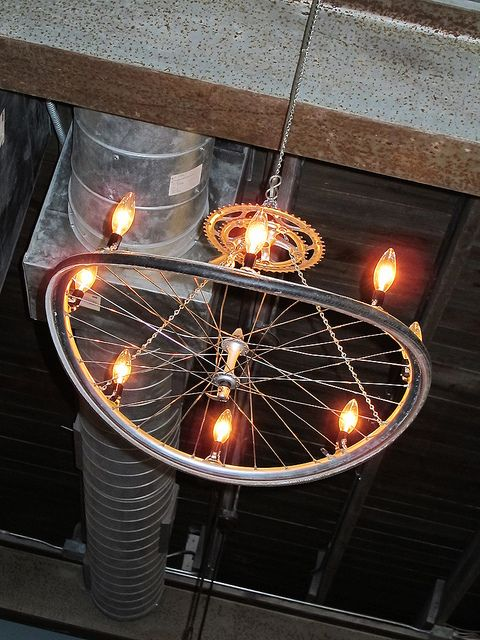 Chandelier at Bouldin Creek Cafe made out of a bicycle wheel and gear.