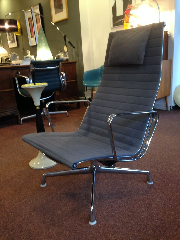 Eames EA124 lounge chair , Herman Miller from december 1989 with chrome legs and arms