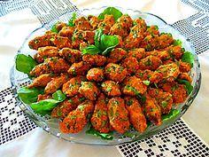 mercimek köftesi (merjimeck kofte)  bulgur (cracked wheat), red lentil, fresh herbs!  SO GOOD!