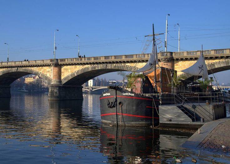 Old Boat Anchored on the Vltava River at the Palacký Bridge in Prague  #prague #travel #naplavka #boat #old #anchor #dock #vltava #river #water #riverbank #palacky #bridge #bluesky #afternoon #street #streetphotography #nikon #nikonphotography #tamron